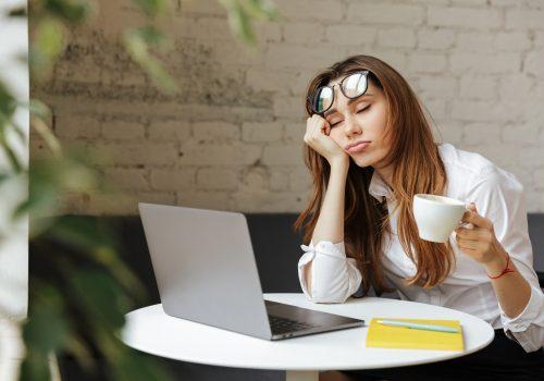 Woman_Falling_Asleep_While_Working